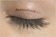 A tattoo on a woman's eyelid advertises a web site