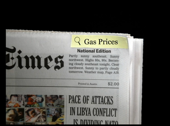 "a newspaper with ""gas prices"" highlighted as if on a digital reader"