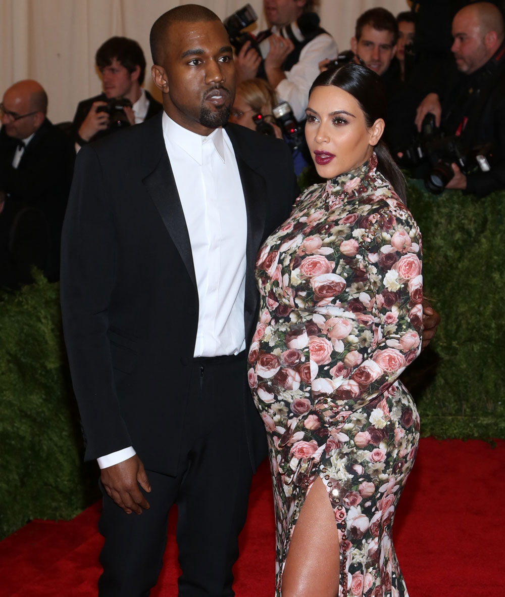Kanye West and Kim Kardashian pose for a red carpet photo at Monday's Met Gala in NYC.