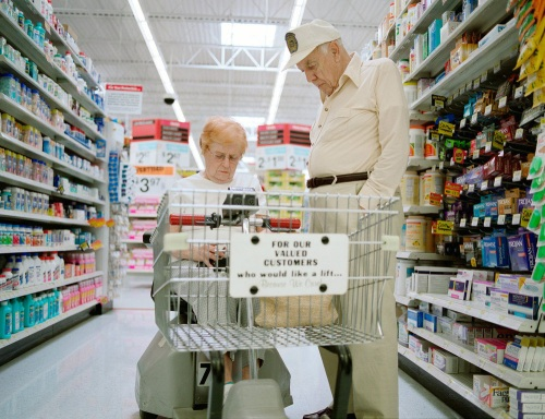 Two elderly people shopping