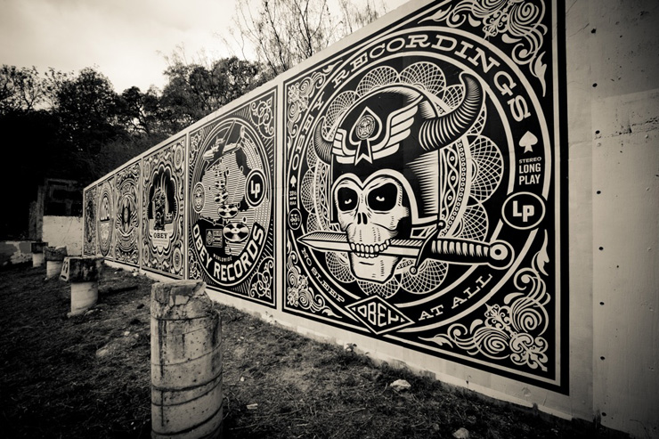 A photograph of Shepherd Fairey's inaugural designs on the HOPE Outdoor Gallery in Austin.