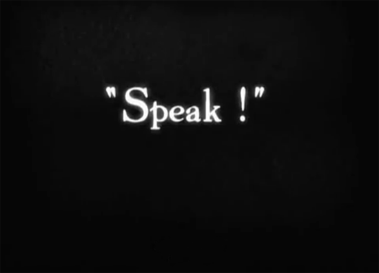 "Intertitle from The Artist; white letters against a black background say, ""Speak!"""