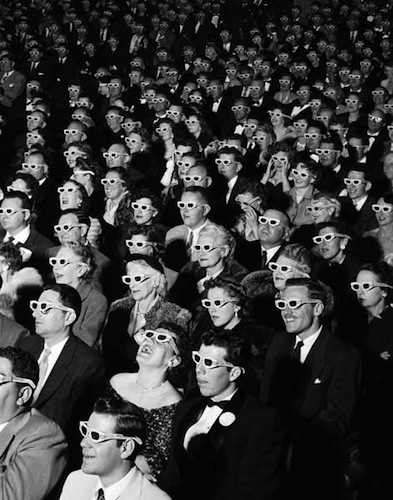 old photo of theater audience in 3D glasses