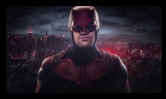A glum Daredevil stands in front of a red-tinged New York skyline.