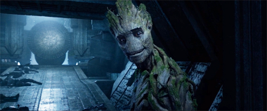 The tree-like Groot smiles gently. Behind him? A pile of dead bodies.
