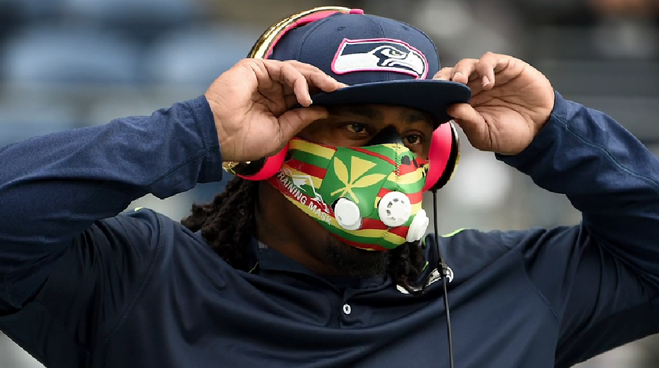 Marshawn Lynch in a multicolored high-altitude breathing mask.