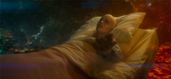 Quill's mother lies in her hospital bed, now suspended against a red-and-blue background that evokes pictures of nebulas.