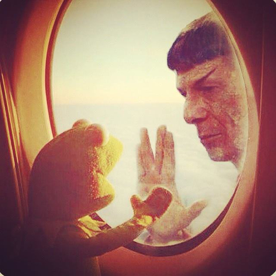 Leonard Nimoy and Kirmit place their hands to opposite sides of a sci-fi window, in a recreation of a scene from Star Trek II: The Wrath of Khan