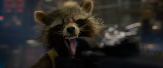 Rocket Raccoon screams as he shoots a giant gun.