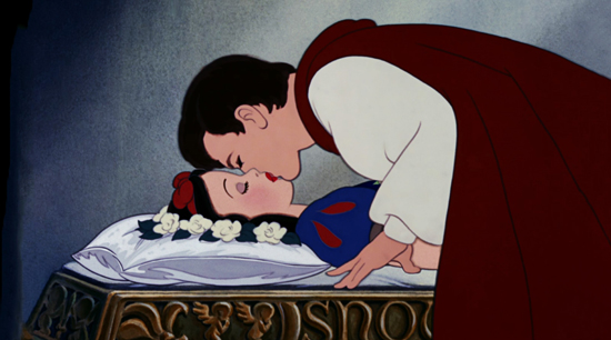 Snow White, in a dress of blue and red, is kissed by her prince charming.