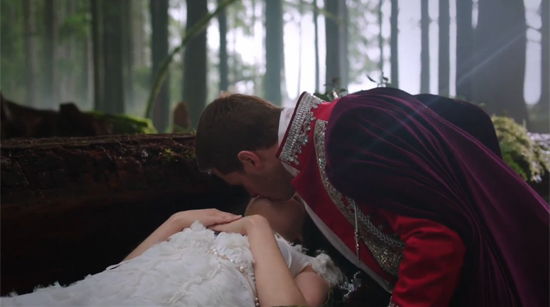 A live-action version of Snow White is kissed by her suitor. Her dress is white and frilly. Oh so very frilly. Like, all the frills.