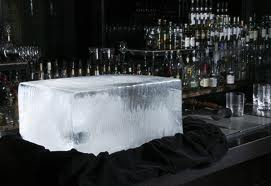 a large block of ice on a fancy bar