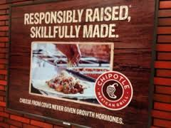 a chipotle sign that says responsibly raised
